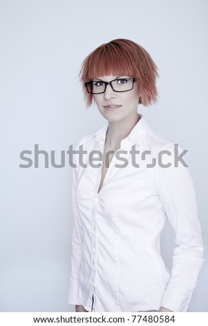 A portrait of an attractive girl with red hair and glasses