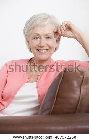 A portrait of an attractive senior woman, relaxing
