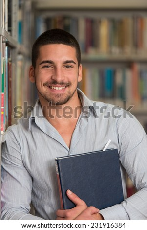 A Portrait Of An Caucasian College Student Man In Library - Shallow Depth Of Field - stock photo