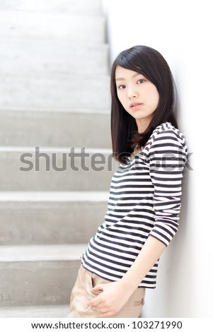 a portrait of attractive asian woman relaxing in the room - stock photo