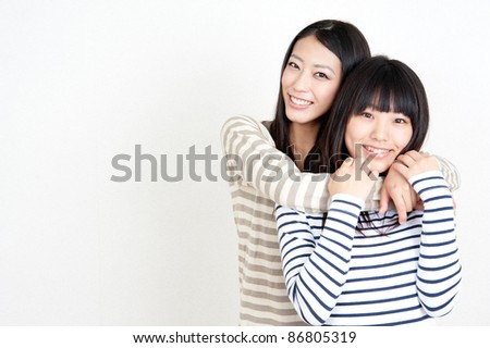 a portrait of attractive asian women isolated on white background - stock photo