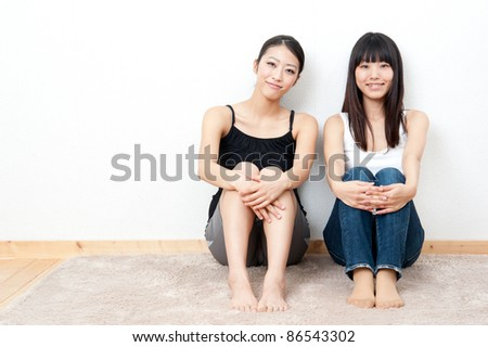 a portrait of attractive asian women sitting