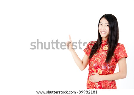 a portrait of attractive chinese woman pointing - stock photo