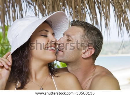 a portrait of attractive couple having fun on the beach.