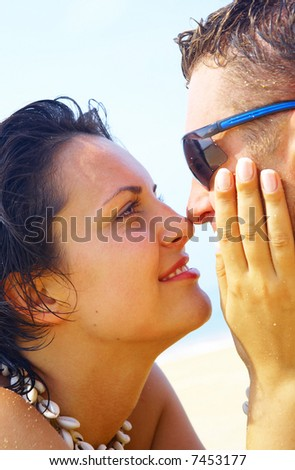 a portrait of attractive couple having fun on the beach