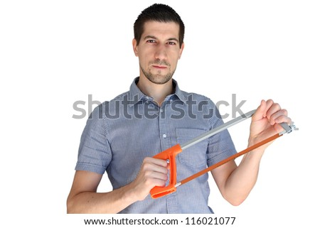 A portrait of attractive young man holding a handsaw