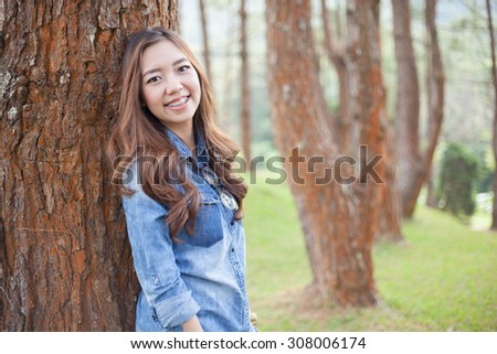 A portrait of beautiful asian woman on the park - stock photo