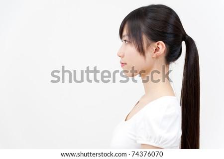 a portrait of beautiful asian woman with ponytail hair - stock photo