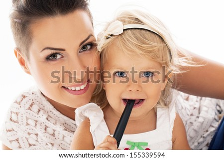A portrait of beautiful mother and her adorable daughter in the park