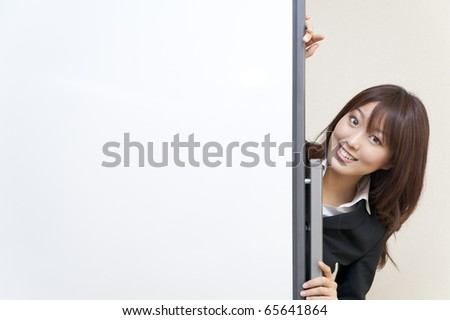 a portrait of business woman and blank white board - stock photo