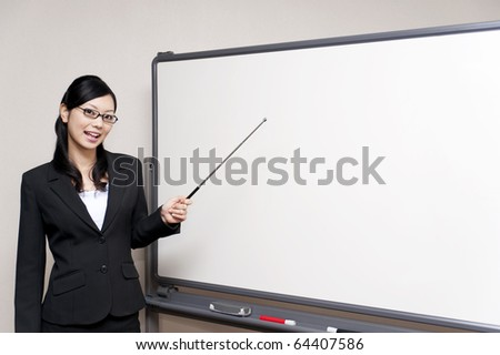 a portrait of business woman pointing at the whiteboard - stock photo