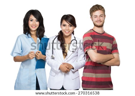 A portrait of doctor, nurse, and patient smiling - stock photo