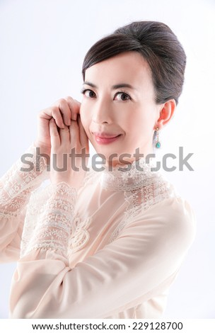 A portrait of elegant woman is in fashion style. - stock photo