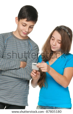 A portrait of fashion kids with a cell phone; isolated on the white background