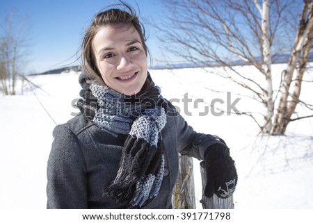 A Portrait of happy young woman have fun at beautiful sunny winter day