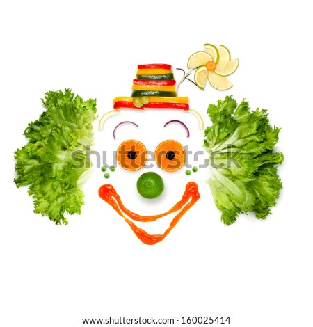 A portrait of joyful clown made of vegetables and sauce. - stock photo