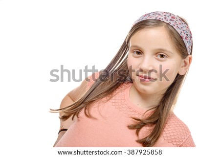 a portrait of pre teenage girl isolated on a white background