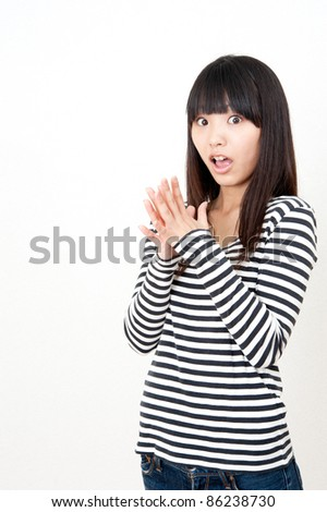 a portrait of pretty asian woman surprising - stock photo