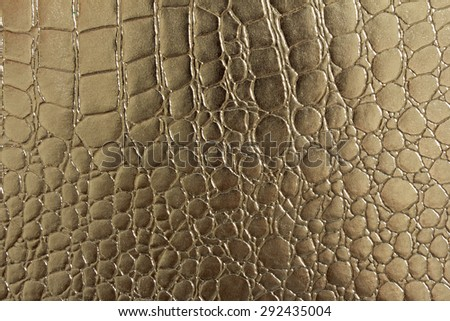 A portrait of Seamless pattern of crocodile textured leather with gold color - stock photo