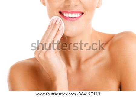 A portrait of sensual woman removing makeup over white background