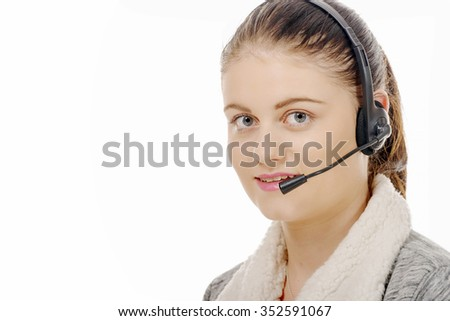 a portrait of smiling cheerful support phone operator in headset.