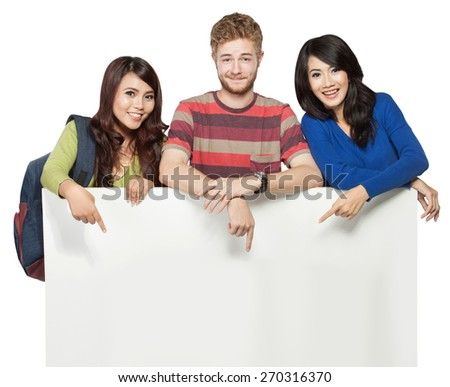 A portrait of smiling students holding blank white banner isolated on white background - stock photo