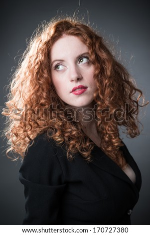 A portrait of stylish elegant redheaded girl with lipstick - stock photo