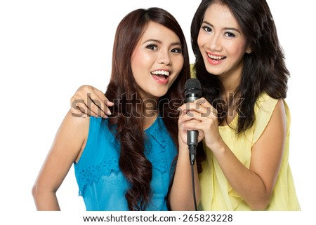 http://thumb1.shutterstock.com/display_pic_with_logo/441070/265823228/stock-photo-a-portrait-of-two-asian-girls-singing-together-265823228.jpg