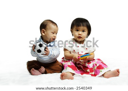 A portrait of two children playing together - stock photo