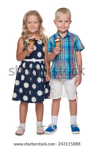 A portrait of two children with ice cream on the white background - stock photo