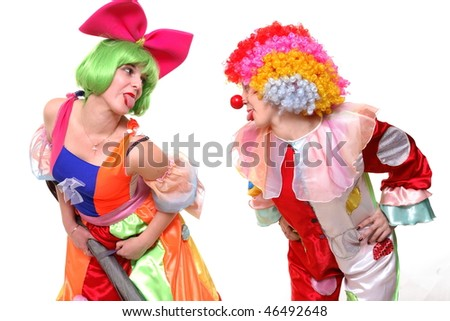 A portrait of two clown-girls in bright costumes