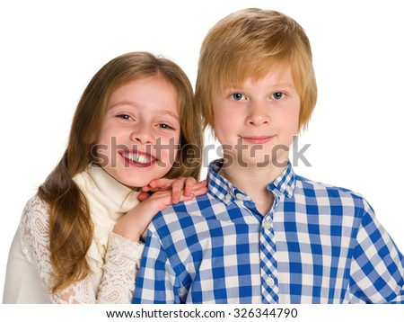 A portrait of two smiling children against the white background