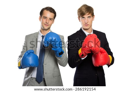 A portrait of two young businessman with boxing gloves, rivalry concept, isolated - stock photo