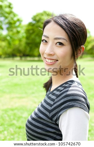 a portrait of young asian woman in the park