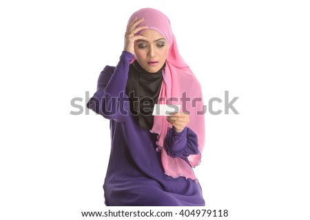 a portrait of young beautiful asian muslim woman holding a card in case of headache. Isolated white - stock photo