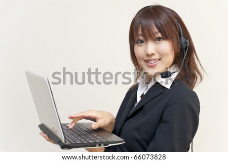 a portrait of young business woman with laptop computer