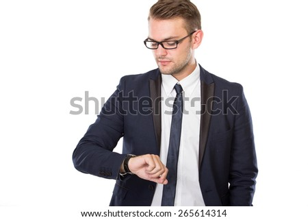 A portrait of Young businessman look at his watches, isolated - stock photo