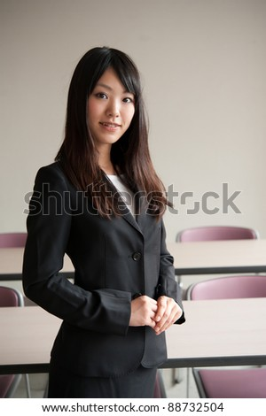 a portrait of young businesswoman in office room