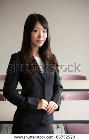 a portrait of young businesswoman in office room - stock photo