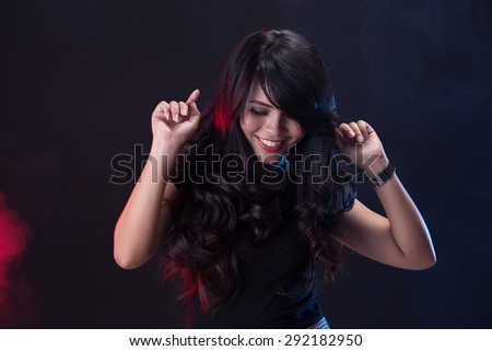 A portrait of young woman dancing on the disco party - stock photo
