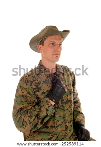 A portrait picture of a young soldier in camouflage uniform with a hat and black gloves, isolated for white background.  - stock photo