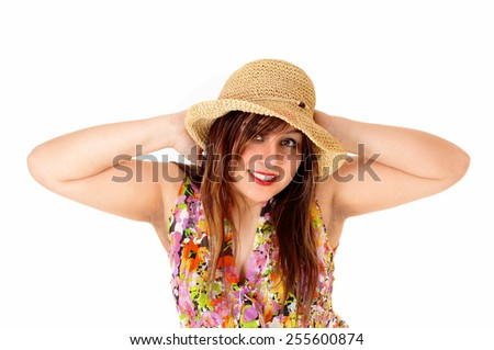 A portrait shot of a happy young woman wearing a straw hat and blousewith her hand behind her head, isolated for white background. - stock photo