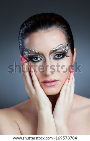 A portrait shot of beautiful woman with jewelry make-up