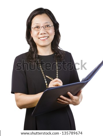 A portrait Vertical photo of a mature Asian woman wearing a dark dress while holding a folder and pen on a white background - stock photo