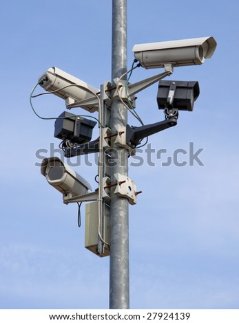 a post full of surveillance cameras