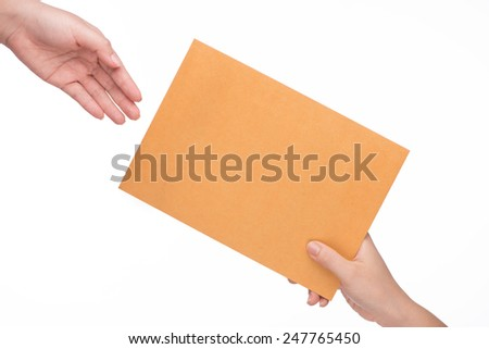 A postman delivering mail isolated on white background by hand. Close-up Of Mailman Delivering Mail To Person Over White Background - stock photo