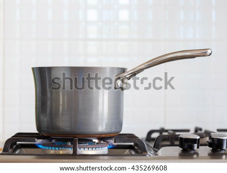 A pot on a gas cooker - stock photo