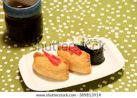 a pouch of fried bean curd stuffed with vinegared rice-inarizushi