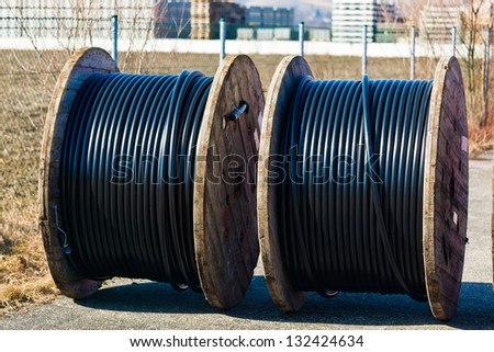 a power line cable rolled up after production. - stock photo