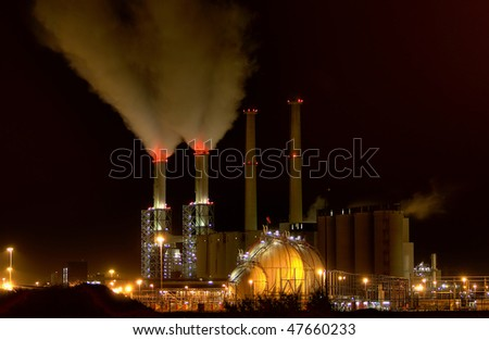 A power-plant at night - stock photo